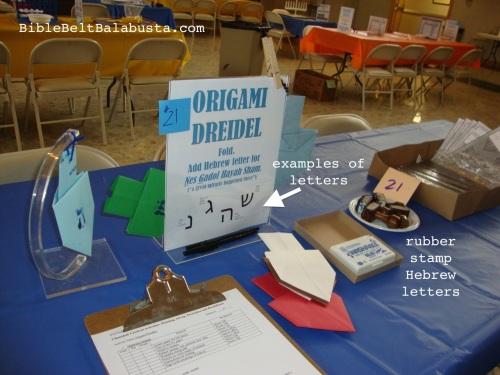 Origami Dreidel station at a Hanukkah carnival
