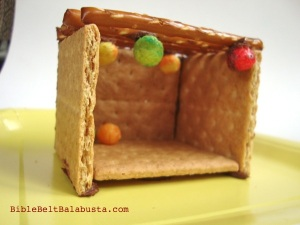 "Add pretzel stick roof. ""Glue"" Trix cereal ""fruit"" on the bottom of sticks."