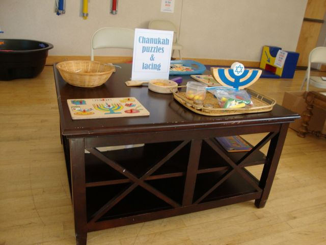 Chanukah Puzzles and Lacing Station for young children at Carnival
