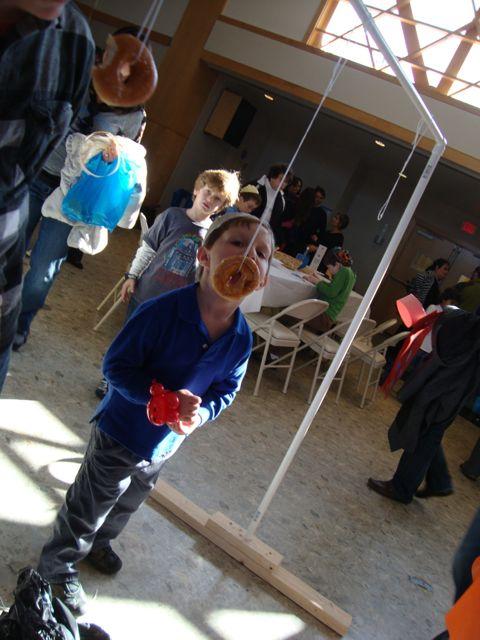 Sufganiyah on a Sting (doughnut game at Chanukah Carnival)