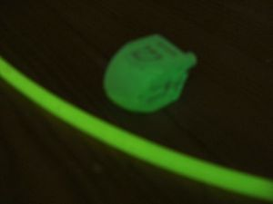 Glow-in-the-dark dreidel and arena
