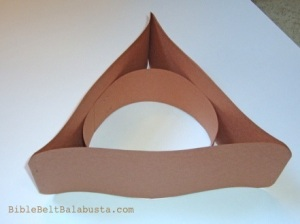 and staple headband inside circle.  Attach tissue to inside of triangle.