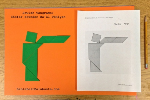 craft foam tangrams on construction paper