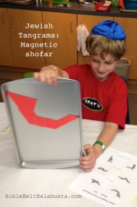 magnetic foam tangrams on cookie sheet