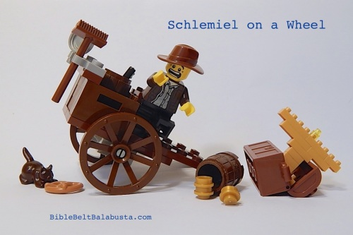 Schlemiel on a Wheel (clumsy pushcart seller)