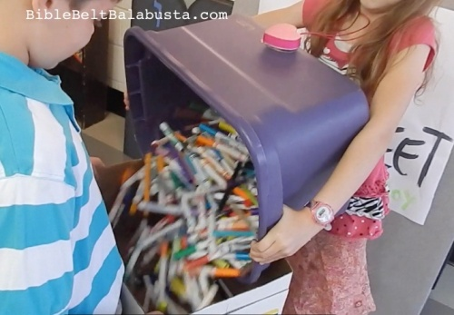 pouring our markers into shipping box